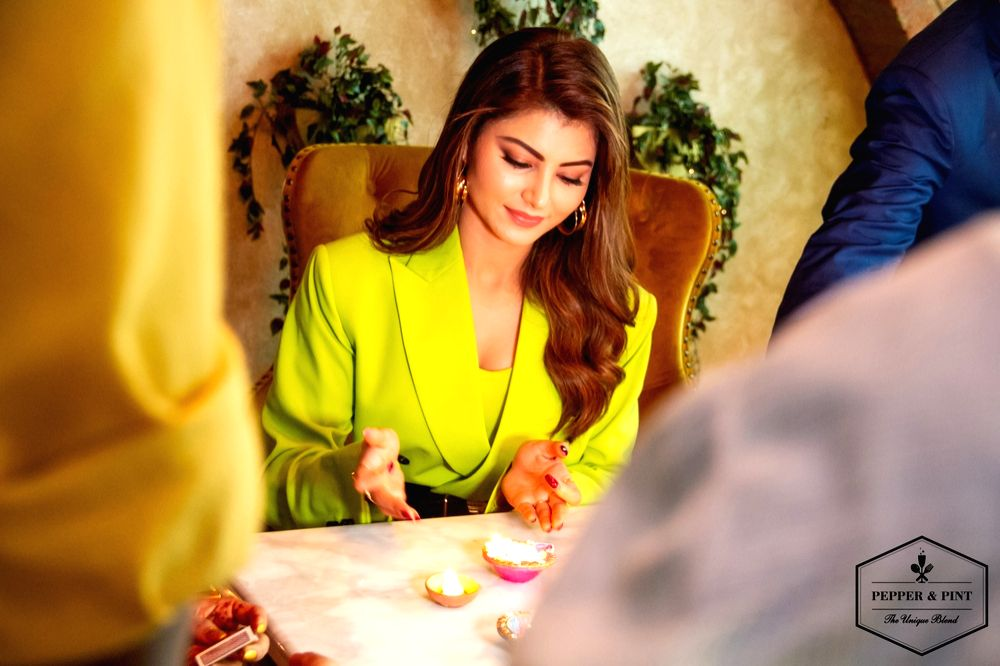 Actress Urvashi Rautela is grabbing all the attention with her latest neon look. She was recently spotted at Pepper & Pint restaurant in Mumbai, wearing a neon green coloured coat dress. Urvashi ... - Urvashi Rautela