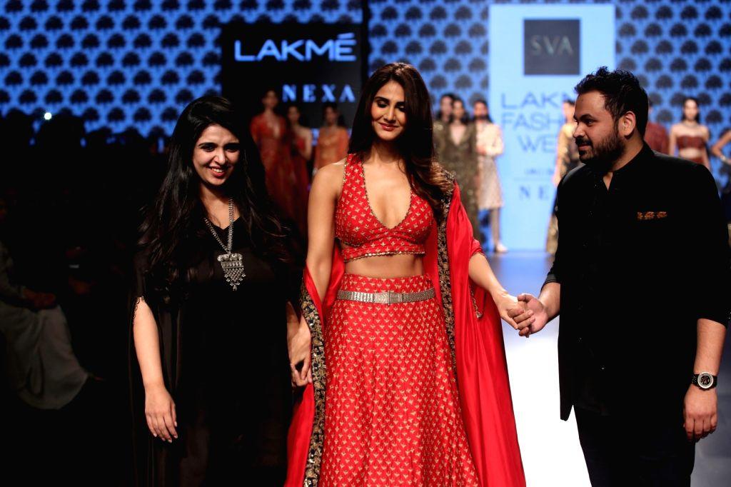 Actress Vaani Kapoor walks on the ramp for fashion designers Paras and Sonam Modi during the Lakme Fashion Week Winter/Festive 2017 in Mumbai on Aug 19, 2017. - Vaani Kapoor and Sonam Modi