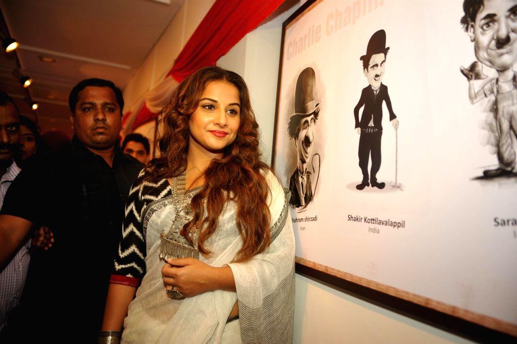 Actress Vidya Balan during the inauguration of exhibition Chaplin Lines, in Mumbai on June 25, 2015.