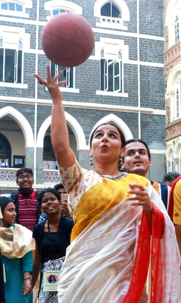 Actress Vidya Balan plays basketball with the students at Finding Mother Conference at St Xaviers College in Mumbai on Feb 12, 2020. - Vidya Balan