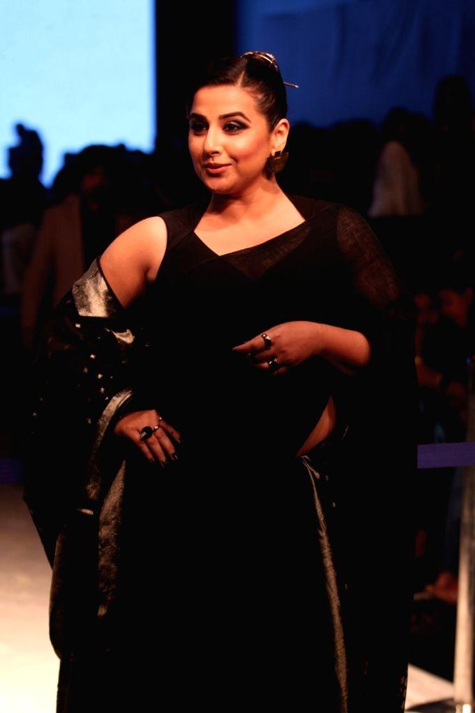 Actress Vidya Balan showcases fashion designer Anavila Misra's creation during Lakme Fashion Week (LFW) Summer/Resort 2019 in Mumbai, on Feb 1, 2019. - Vidya Balan