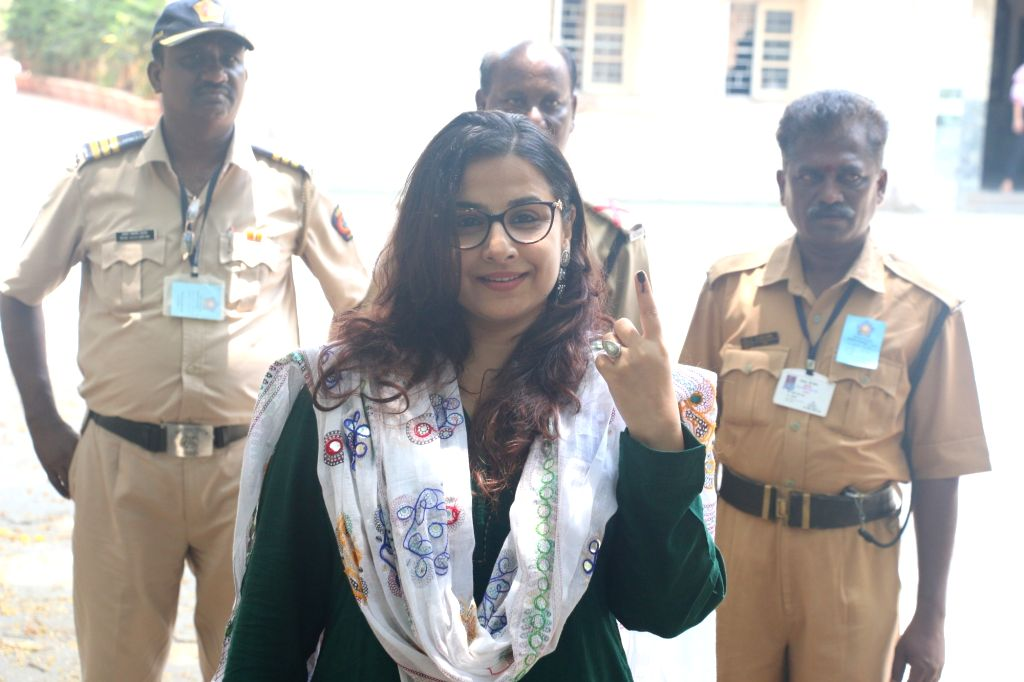 Actress Vidya Balan shows her inked finger after casting her vote for the fourth phase of 2019 Lok Sabha elections, in Mumbai on April 29, 2019. - Vidya Balan