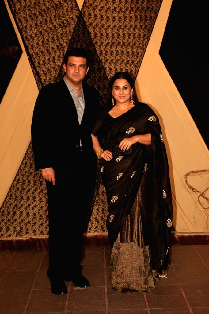 Actress Vidya Balan with her husband Siddharth Roy Kapur at the wedding reception of director Mukesh Bhatt and Nilima Bhatt's daughter Sakshi Bhatt in Mumbai, on Jan 25, 2019. - Vidya Balan and Siddharth Roy Kapur