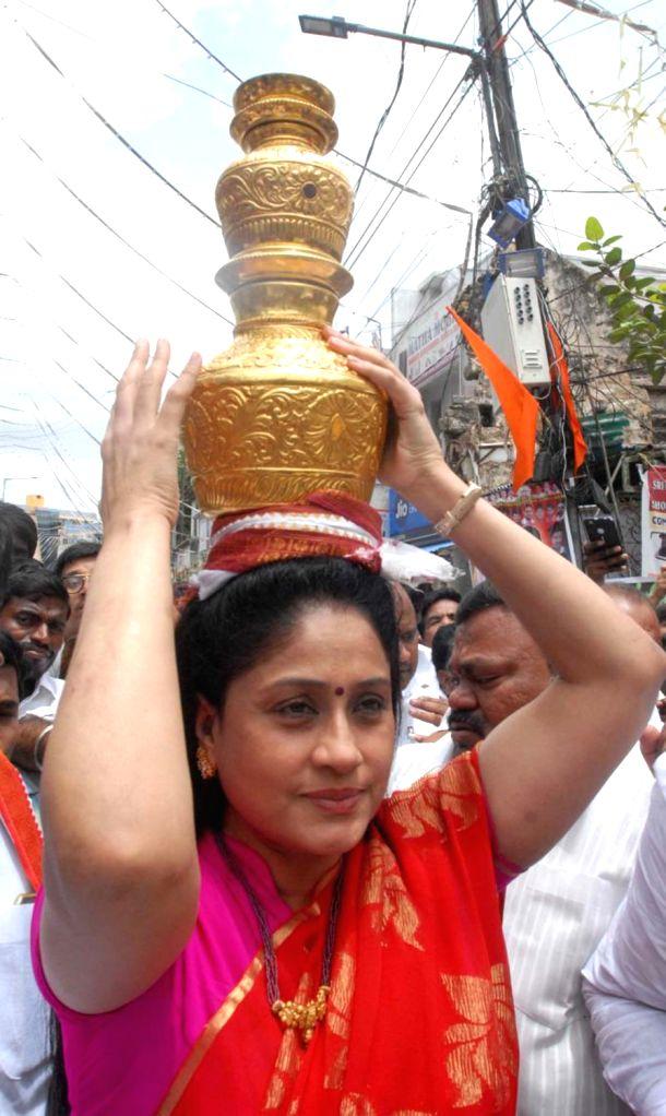 Actress Vijayashanti carries a golden pot as she participates in Bunalu celebrations in Hyderabad on Aug 5, 2018. - Vijayashanti