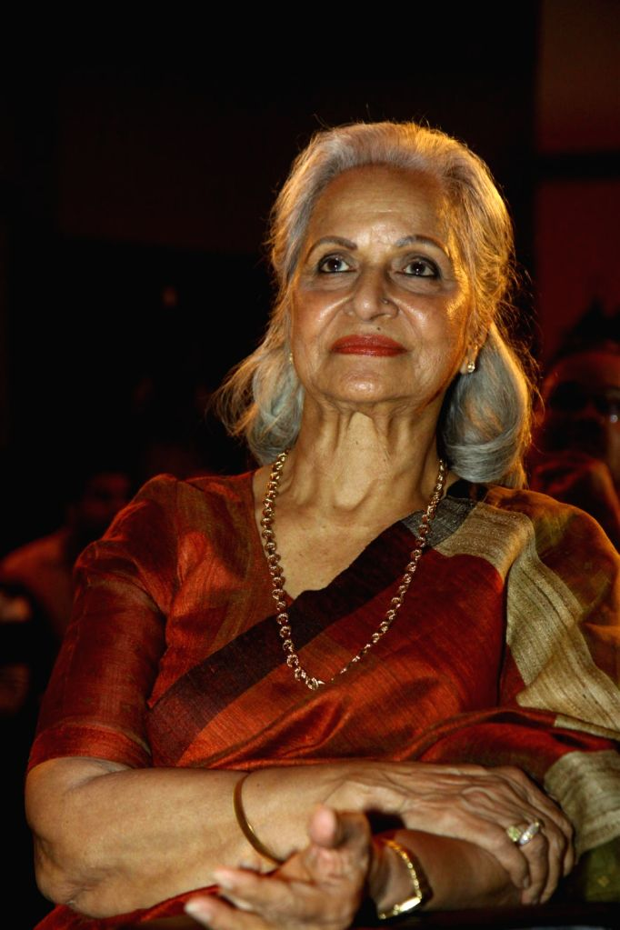 Actress Waheeda Rehman during unveiling of hand impression of Veteran actress Asha Parekh as a tribute to her contribution to the film industry in Mumbai on Dec.6, 2013. - Waheeda Rehman