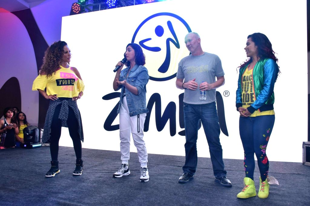 Actress Yami Gautam addresses at a promotion of Zumba - an exercise fitness program, in Mumbai, on March 15, 2019. Also seen Zumba expert Gina Grant. - Yami Gautam