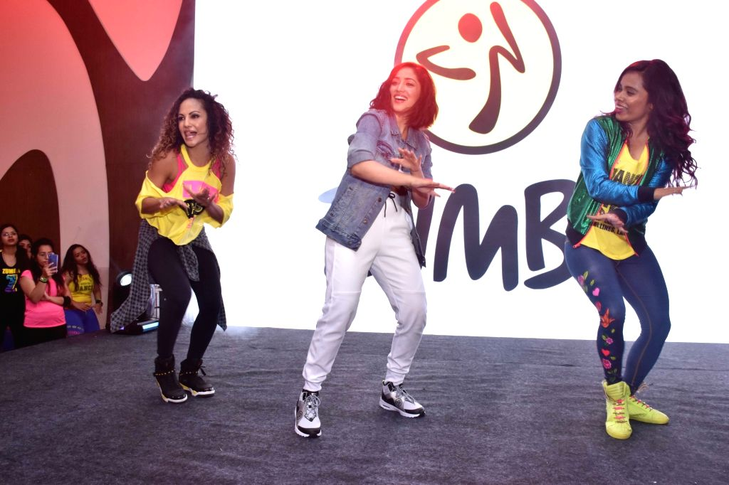 Actress Yami Gautam and Zumba expert Gina Grant perform during the promotion of Zumba - an exercise fitness program in Mumbai, on March 15, 2019. - Yami Gautam