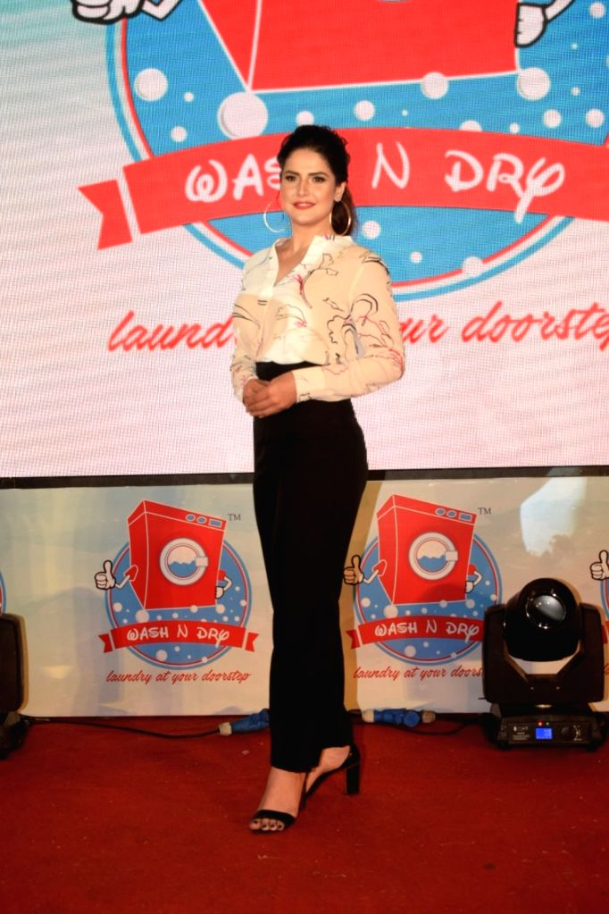 Actress Zareen Khan at the launch of  Wash N Dry app in Mumbai on Sept 9, 2018. - Zareen Khan