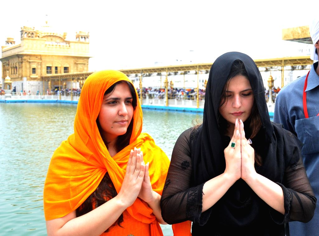 Actress Zarine Khan along with her sister paying obeisane at Golden Temple in Amritsar on July 26, 2014.