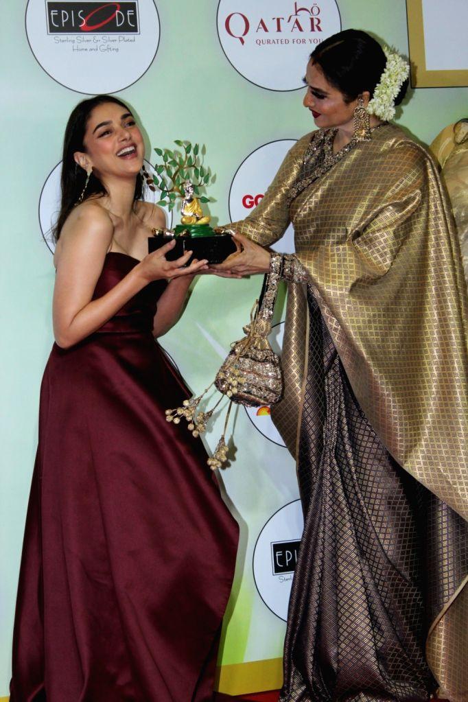 Actresses Aditi Rao Hydari and Rekha on the red carpet of the GeoSpa Awards 2019, in Mumbai, on April 24, 2019. - Aditi Rao Hydari and Rekha