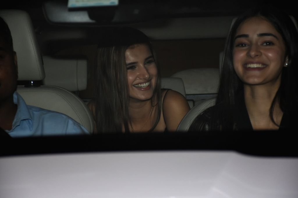 Actresses Ananya Panday and Tara Sutaria arrive at filmmaker Karan Johar's house party, in Mumbai on June 12, 2019. - Ananya Panday and Tara Sutaria