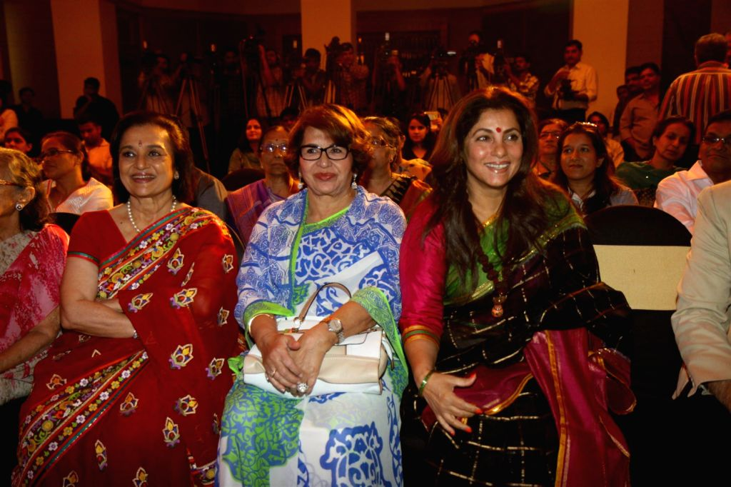 Actresses Asha Parekh, Helen and Dimple Kapadia during unveiling of hand impression of Veteran actress Asha Parekh as a tribute to her contribution to the film industry in Mumbai on Dec.6, 2013. - Helen and Dimple Kapadia