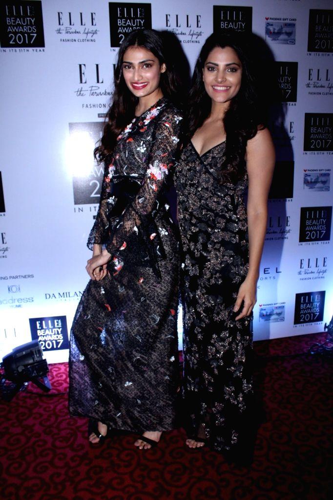 "Actresses Athiya Shetty and Saiyami Kher during the ""Elle India Beauty Awards 2017"" in Mumbai on Oct 4, 2017. - Athiya Shetty and Saiyami Kher"