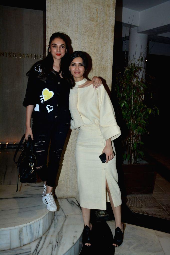 Actresses Diana Penty and Aditi Rao Hydari at a house party hosted by fashion designer Manish Malhotra in Mumbai, on March 13, 2019. - Diana Penty, Aditi Rao Hydari and Manish Malhotra