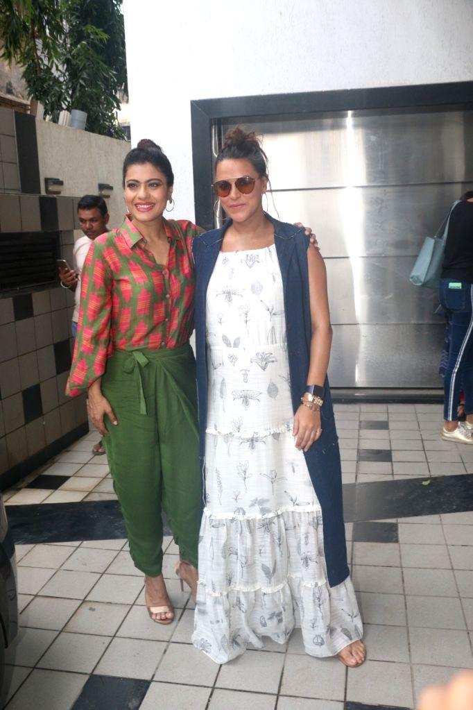 Actresses Kajol and Neha Dhupia during the recording for #NoFilterNeha Season 3 in Mumbai on Sept 15, 2018. - Kajol and Neha Dhupia
