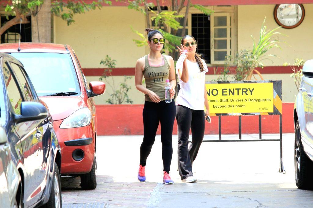 Actresses Kareena Kapoor Khan and Amrita Arora seen at a gym in Mumbai on April 4, 2018. - Kareena Kapoor Khan and Amrita Arora