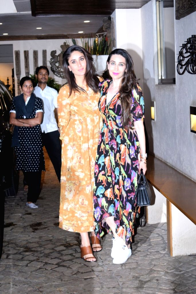 Actresses Kareena Kapoor Khan and Karisma Kapoor seen outside actor Anil Kapoor's house in Mumbai, on Aug 28, 2019. - Anil Kapoo, Kareena Kapoor Khan and Karisma Kapoor
