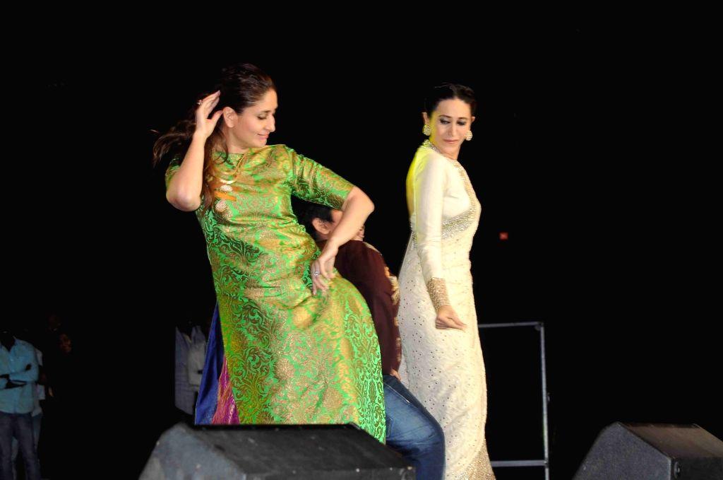 Actresses Karishma Kapoor and Kareena Kapoor during a programme in Hyderabad on Nov 14, 2015. - Karishma Kapoor