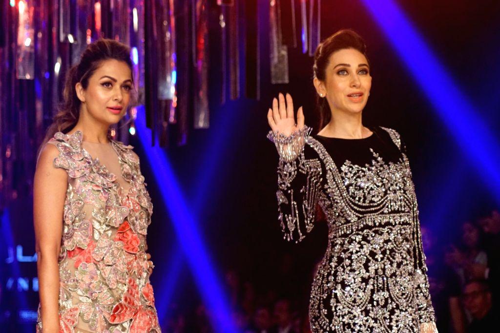 Actresses Karisma Kapoor and Amrita Arora during the Lakme Fashion Week Winter/Festive 2017 in Mumbai on Aug 20, 2017. - Karisma Kapoor and Amrita Arora