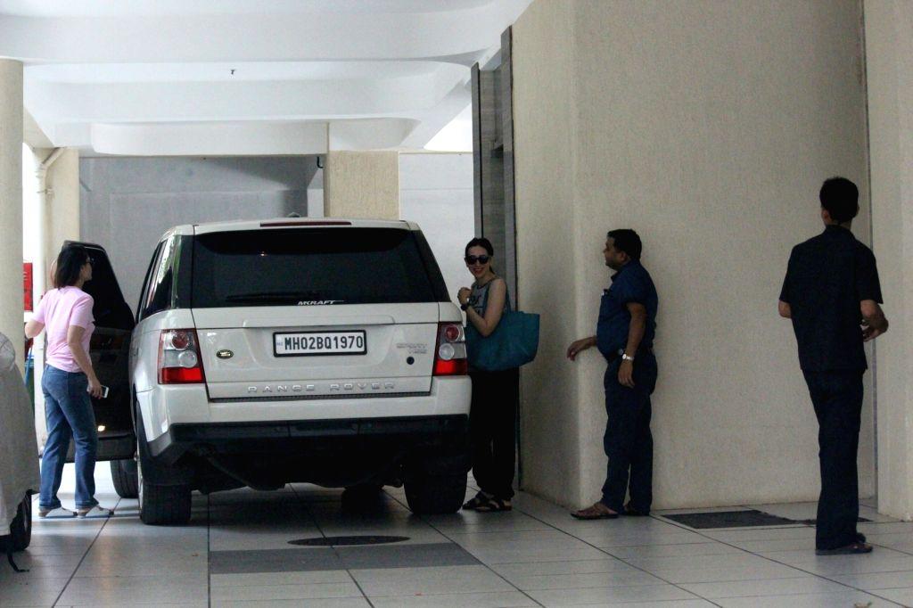 Actresses Karisma Kapoor and Kareena Kapoor seen arriving at their mother's place in Mumbai, on May 20, 2018. - Karisma Kapoor and Kareena Kapoor