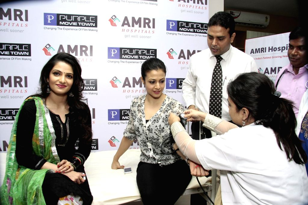 Actresses Koel Mullick and Tanusree Chakraborty during a free health check-up programme for people in the entertainment industry organised by a private hospital at Purple Movie Town in Sonarpur near . - Koel Mullick and Tanusree Chakraborty