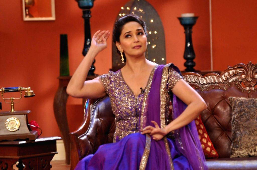Actresses Madhuri Dixit Nene on the sets of Comedy Nights with Kapil to promote her upcoming film Dedh Ishqiya in Mumbai on December 13, 2013. - Madhuri Dixit Nene