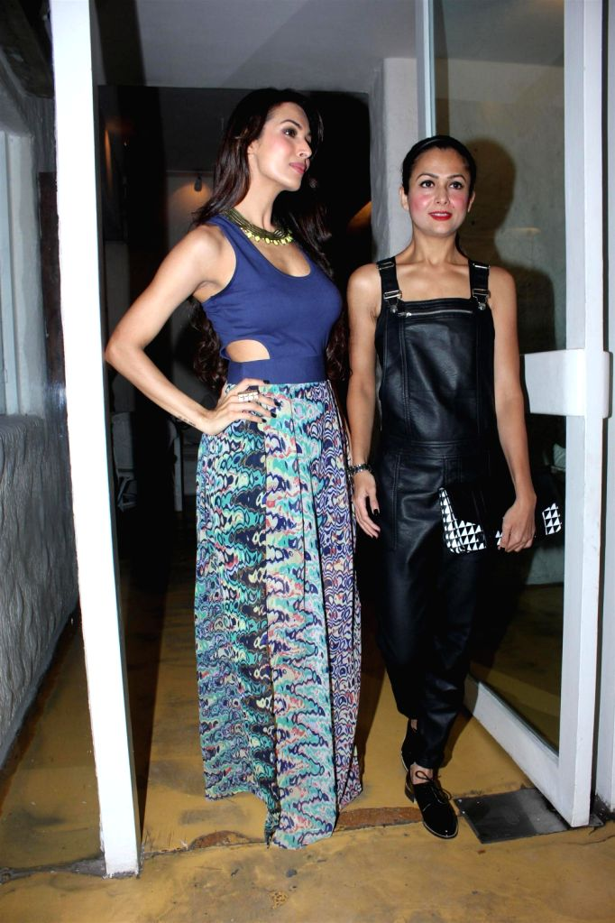 Actresses Malaika Arora Khan and Amrita Arora during the preview collection of The Closet Label at Olive in Mumbai on December 20, 2013. - Amrita Arora