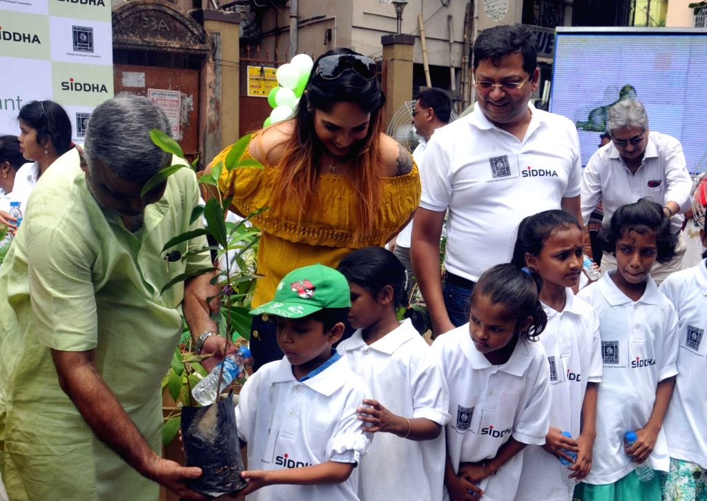 Actresses Mumtaz Sorcar and Debolina Kumar with special children during an environment awareness campaign in Kolkata on June 2, 2017. - Mumtaz Sorcar and Debolina Kumar