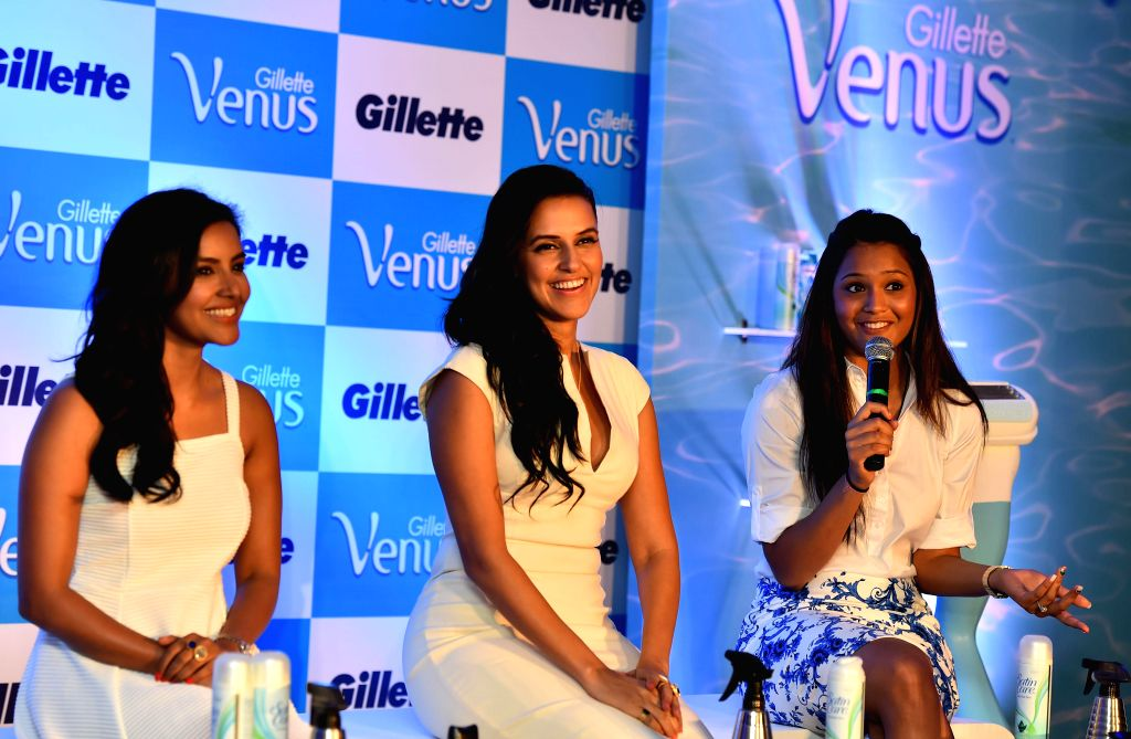 Actresses Neha Dhupia and Priya Anand with Indian squash player Dipika Pallikal during a programme in Chennai on Aug 6, 2014.