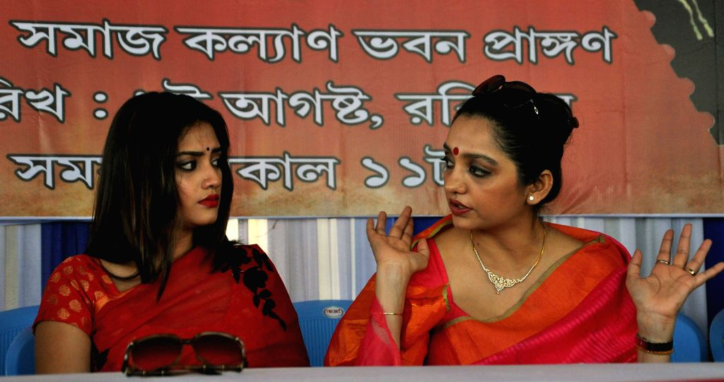 Actresses Nusrat Jahan and June Malia  during a programme organised to mark the the beginning of preparations for Durga Puja at Salt Lake in Kolkata, on Aug 9, 2015.