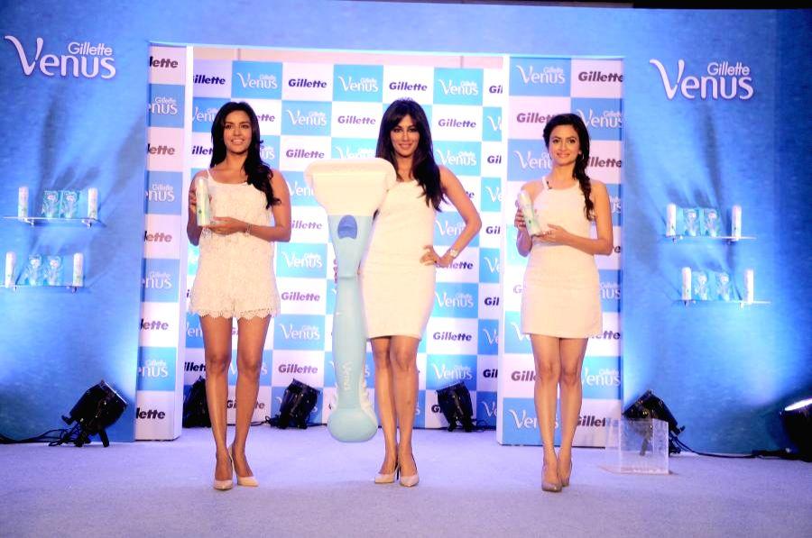 Actresses Priya Anand, Chitrangada Singh and Kriti Kharbanda during a promotional event in Bangalore on Aug 8, 2014. - Priya Anand and Kriti Kharbanda