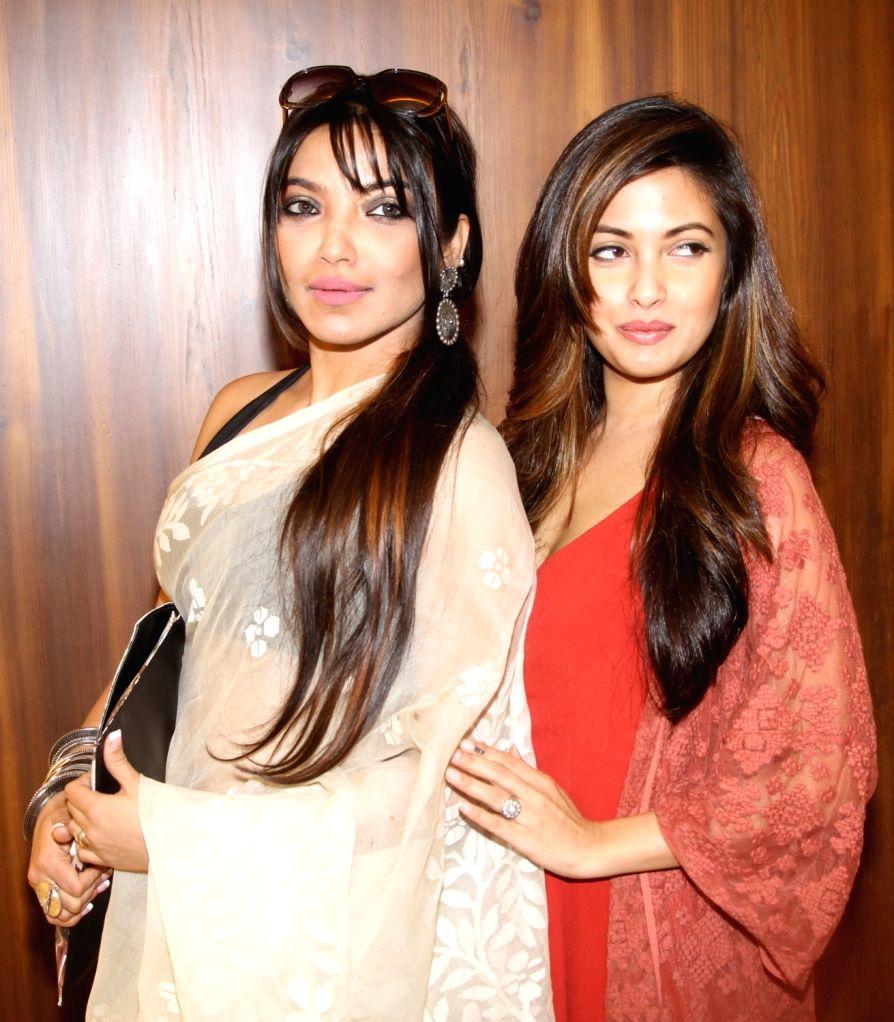 """Actresses Ria Sen and Rupsha Guha Banerjee during a press conference regarding their upcoming film """"Senapati'"""" in Kolkata, on May 6, 2016. - Ria Sen and Rupsha Guha Banerjee"""