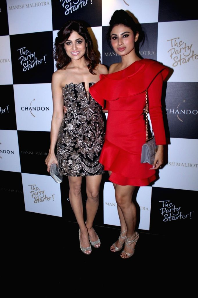 Actresses Shamita Shetty and Mouni Roy during the launch of Manish Malhotra X Chandon Champagne bottles Limited Edition End Of Year 2017 in Mumbai on Oct 9, 2017. - Shamita Shetty and Mouni Roy