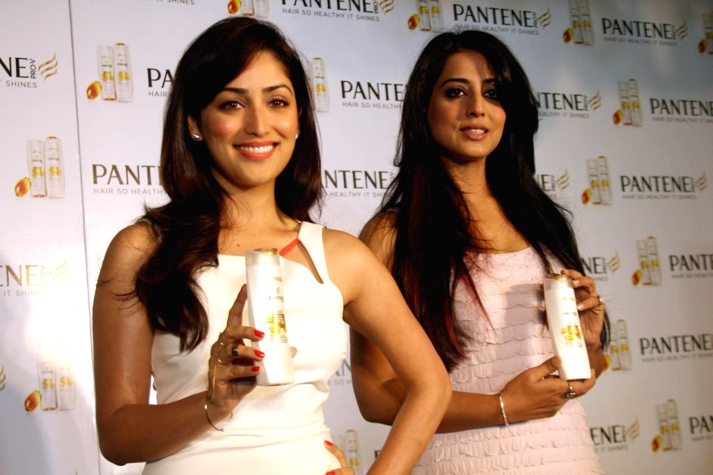 Actresses Yami Gautam and Mahi Gill take extraordinary ``Live Hair Dares`` with Pantene`s new improved range, in New Delhi on June 17,2014.