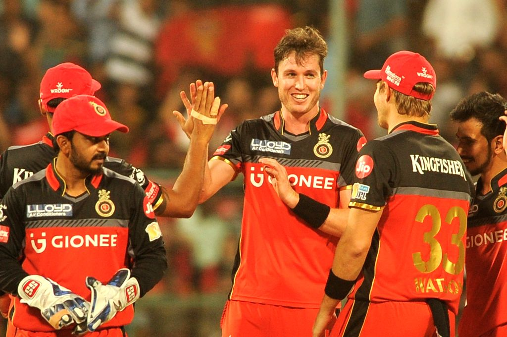 Adam Milne of Royal Challengers Bangalore  celebrates fall of Shardul Thakur's wicket during an IPL 2017 match between Royal Challengers Bangalore and Rising Pune Supergiant at M ...