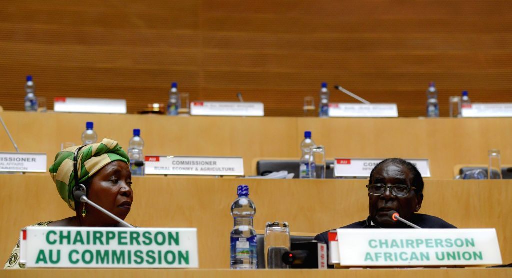 Nkosazana Dlamini-Zuma (L), Chairperson of the African Union (AU) Commission, and new rotating Chairman of the AU and Zimbabwean President Robert Mugabe attend .