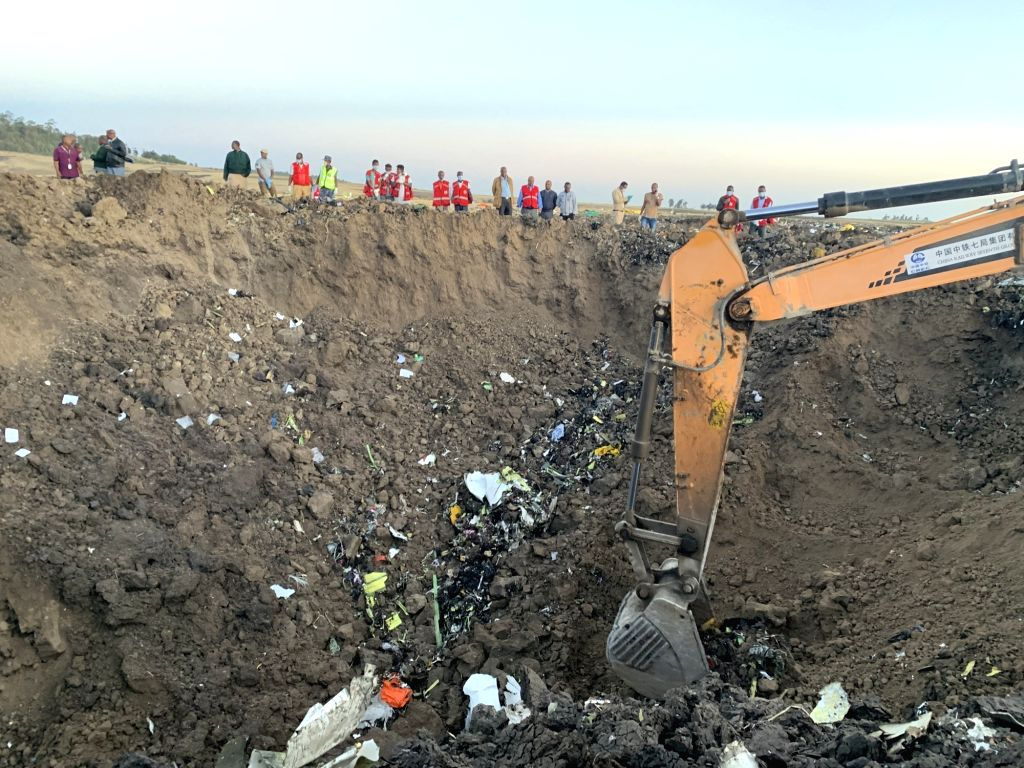ADDIS ABABA, March 10, 2019 - An excavator works at the crash site of an Ethiopian Airlines' aircraft, some 50 km east of Addis Ababa, capital of Ethiopia, on March 10, 2019. All 157 people aboard ...