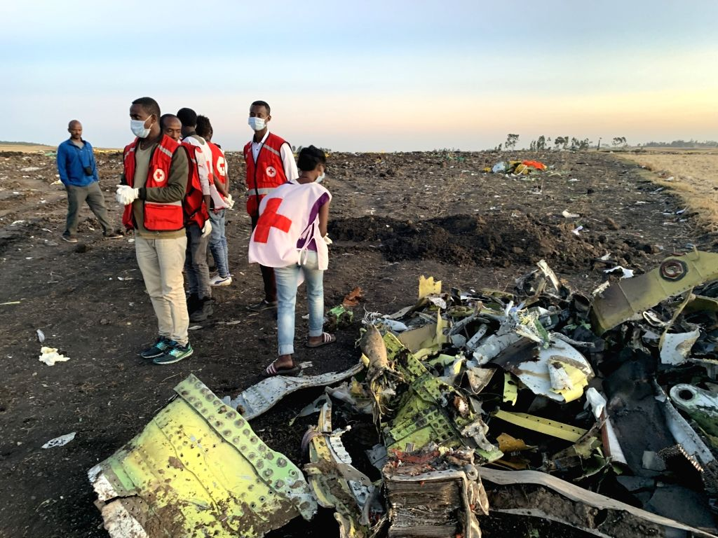 ADDIS ABABA, March 10, 2019 - Rescuers work beside the wreckage of an Ethiopian Airlines' aircraft at the crash site, some 50 km east of Addis Ababa, capital of Ethiopia, on March 10, 2019. All 157 ...