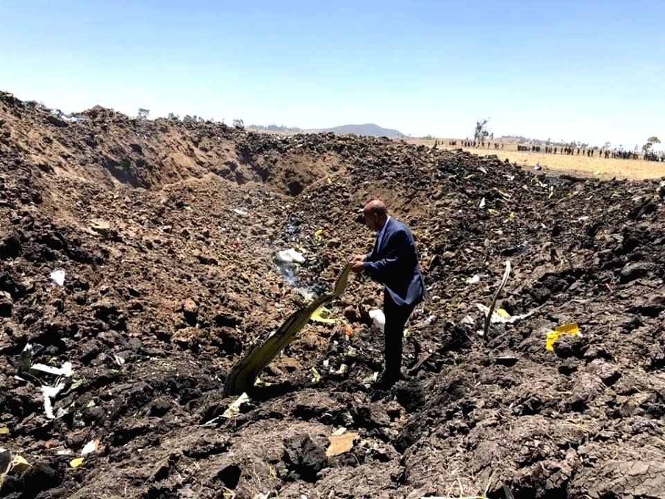 ADDIS ABABA, March 10, 2019 (Xinhua) -- A man checks the wreckage of the airplane of Ethiopian Airlines (ET) which crashed earlier near Bishoftu city, about 45 kms southeast of Addis Ababa, Ethiopia, March 10, 2019. All 149 passengers and eight crew