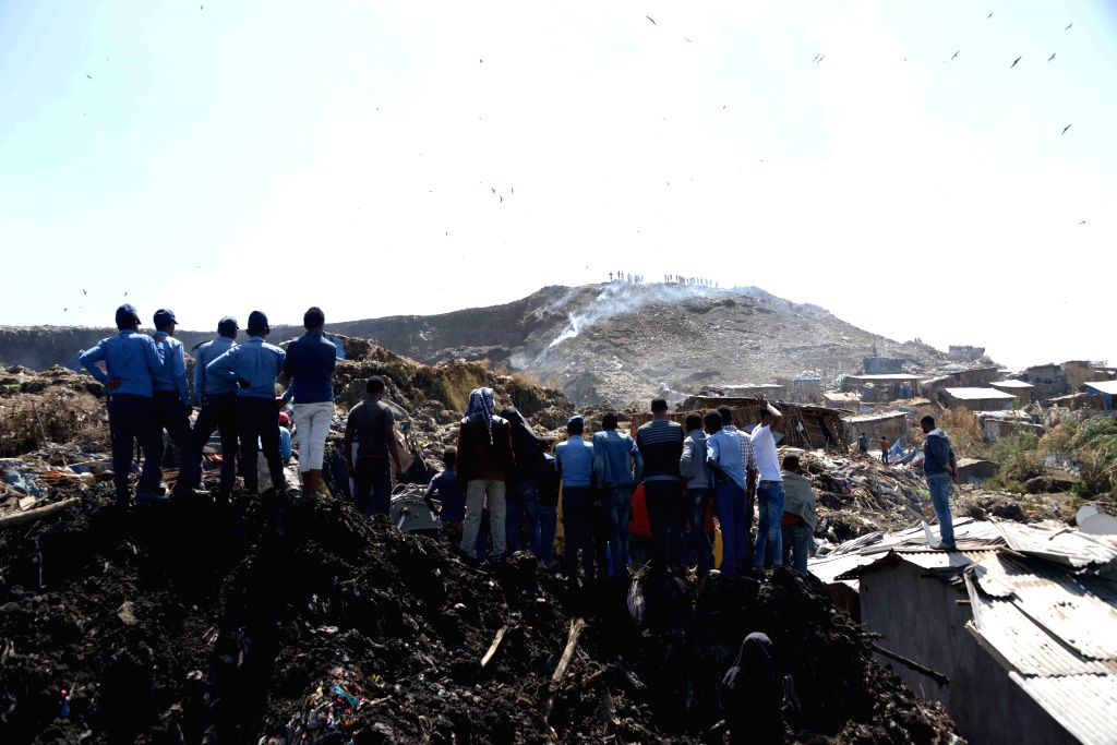ADDIS ABABA, March 12, 2017 - Local residents gather at the site where a massive garbage dump landslide occurred at the outskirts of Ethiopia's capital Addis Ababa, March 12, 2017. The number of ...