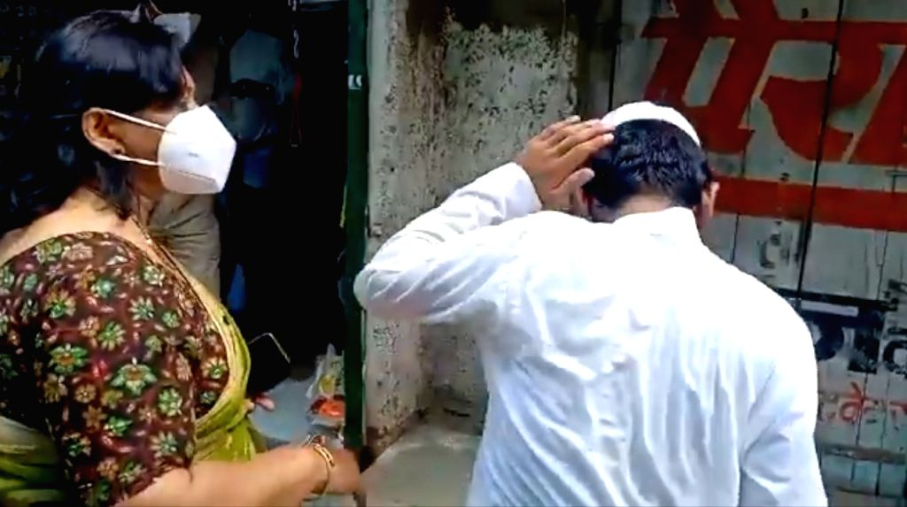 Additional collector slaps child for opening shop in curfew.