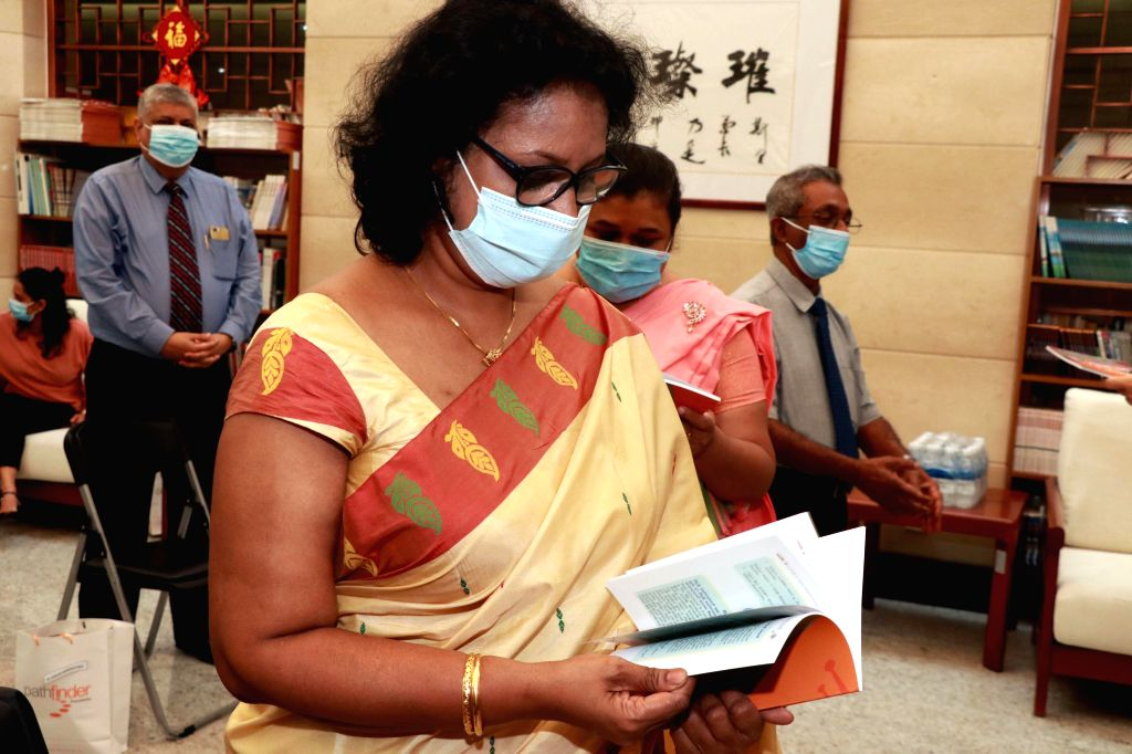 Additional Secretary of Sri Lankan Ministry of Health Dr. Lakshmi Somatunga browses through a translated book at a launch ceremony of the Sinhalese translation of ...