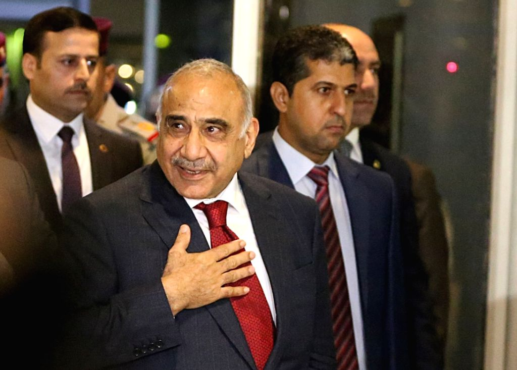 :Adel Abdul Mahdi (Front) arrives at the parliament in Baghdad, Iraq, on Oct. 24, 2018. Adel Abdul Mahdi on Wednesday was sworn in as new prime minister of Iraq ...