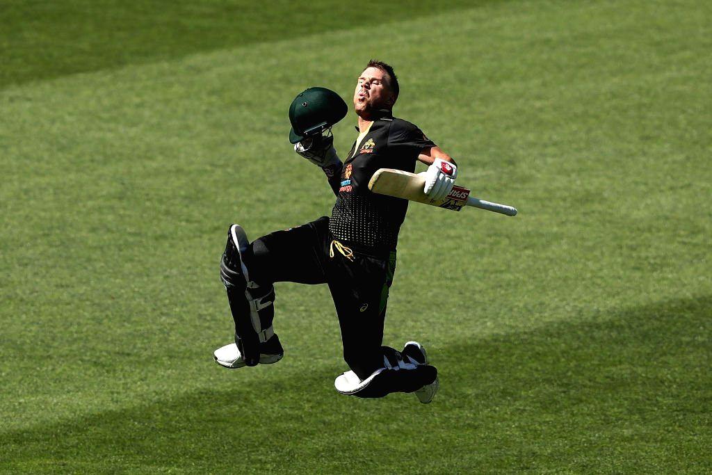 Adelaide: Australia's David Warner celebrates his century during the 1st T20I match between Sri Lanka and Australia at Adelaide Oval in Adelaide on Oct 27, 2019. (Photo: IANS/@ICC)