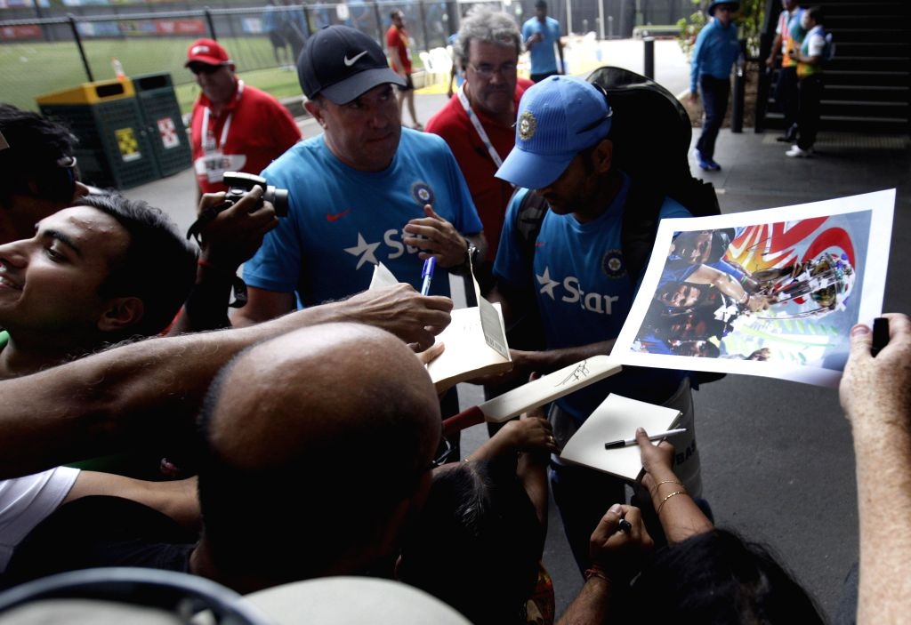 Indian captain M S Dhoni with fans after an ICC World Cup - 2015 practice session at Adelaide Oval in Adelaide,  Australia on Feb 14, 2015. - M S Dhoni