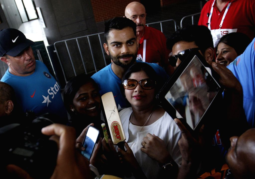 Indian cricketer Virat Kohli with fans after an  ICC World Cup - 2015 practice session at Adelaide Oval in Adelaide,  Australia on Feb 14, 2015. - Virat Kohli