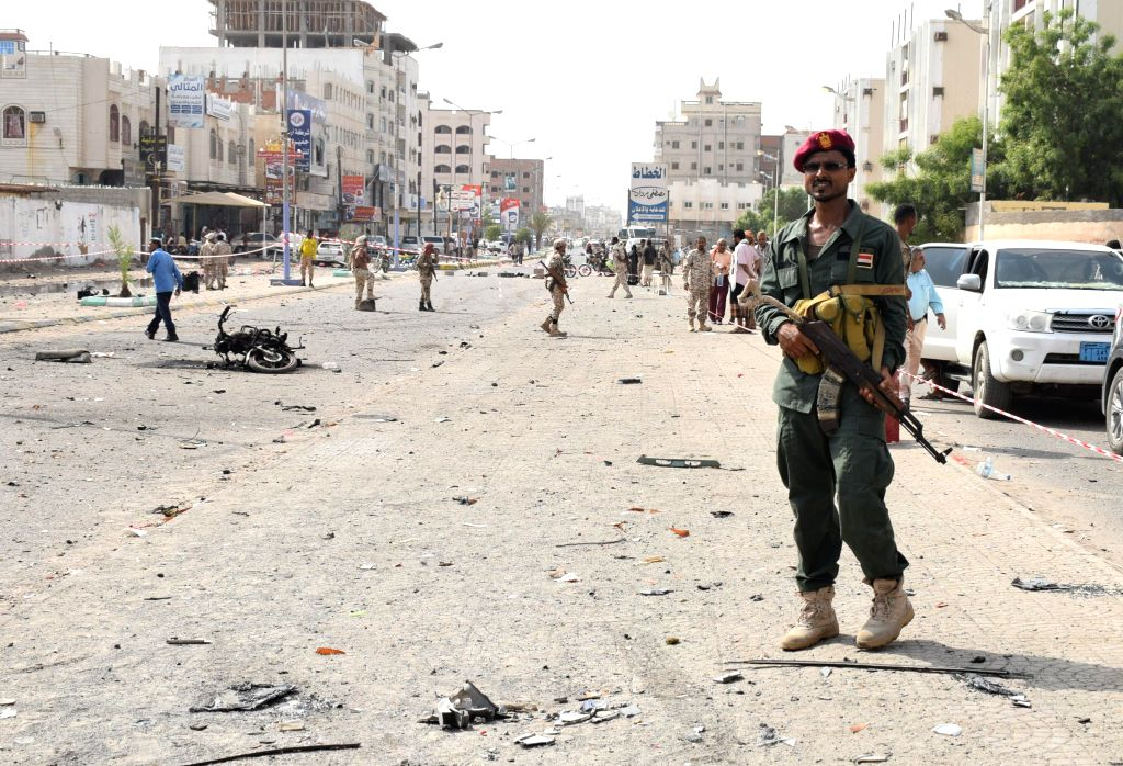 ADEN, Aug. 1, 2019 (Xinhua) -- A soldier secures a car bombing site near a police station in Aden, Yemen, Aug. 1, 2019. A car bombing attack struck a police station on Thursday in Aden's neighborhood of Sheikh Othman, killing four security members an