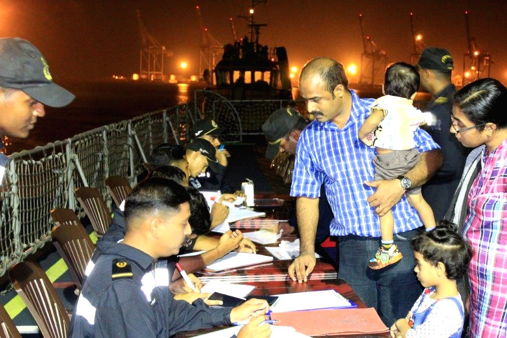 Indians stuck in violence-hit Yemen complete formalities ahead of boarding INS Sumitra at Aden port.