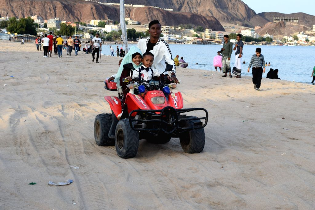 ADEN, June 4, 2019 - Children ride a motorbike on the beach of Buraiga in the southern port city of Aden, Yemen, on June 4, 2019. Thousands of Yemeni people headed on Tuesday to the beaches in the ...