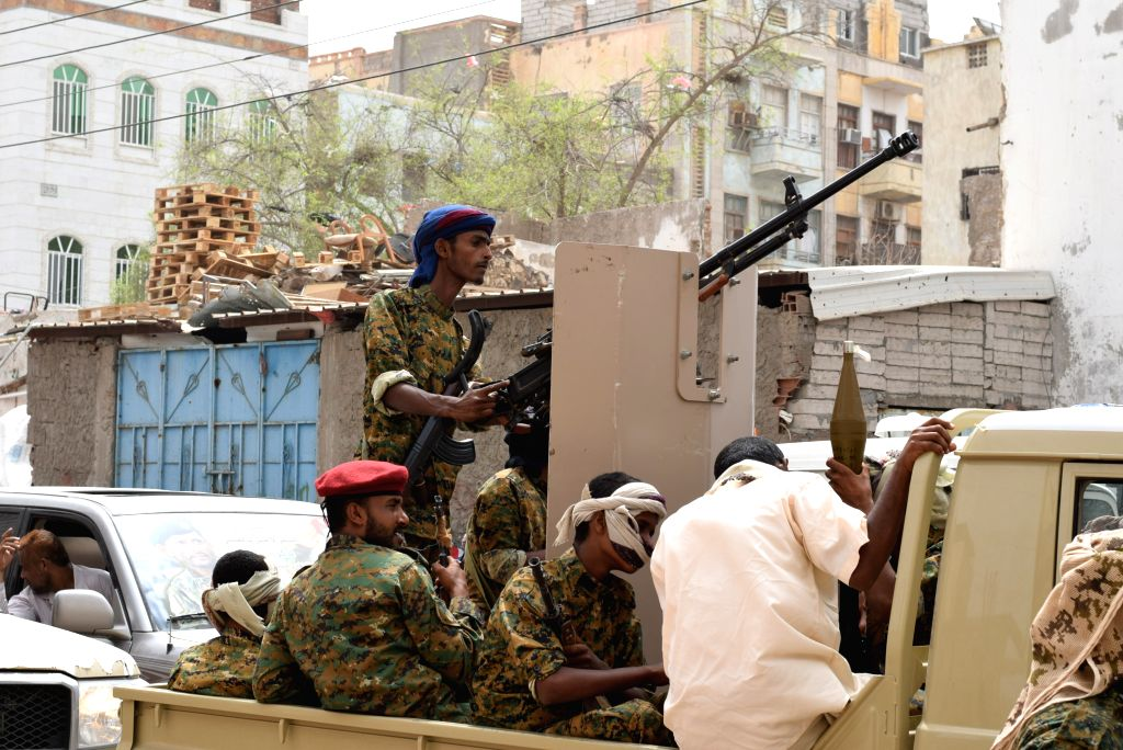ADEN (YEMEN), Aug. 7, 2019 (Xinhua) -- Soldiers loyal to the Southern Transitional Council (STC) guard the mourners in Aden, Yemen, on Aug. 7, 2019. At least two people were killed and 10 others injured in clashes between presidential guard forces an